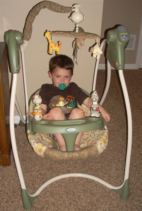 boy baby swings mom mart product review graco lovin hug swing in safari sun