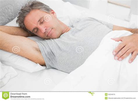 man sleeping in bed man sleeping peacefully royalty free stock photo image