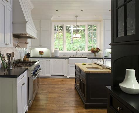 white kitchen with black island black island butcher block top design ideas