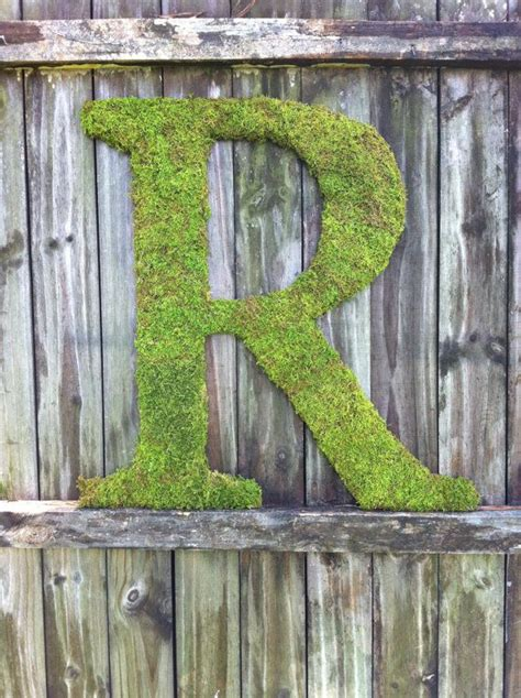 large wood letter r covered in moss rustic wedding