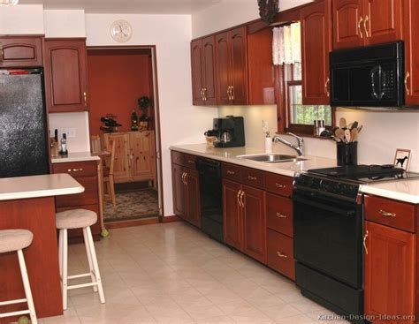 cherry cabinets with black appliances