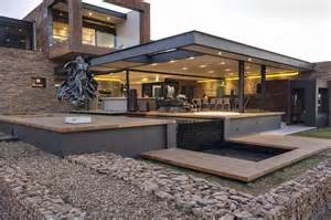 Metal House Designs and steel home with stone and water elements modern house designs
