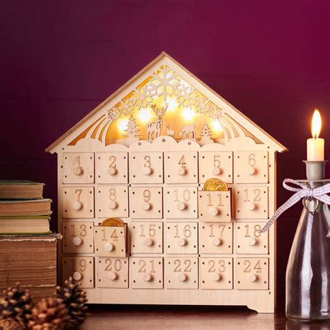 house calendar light up advent calendar house by the christmas home notonthehighstreet com