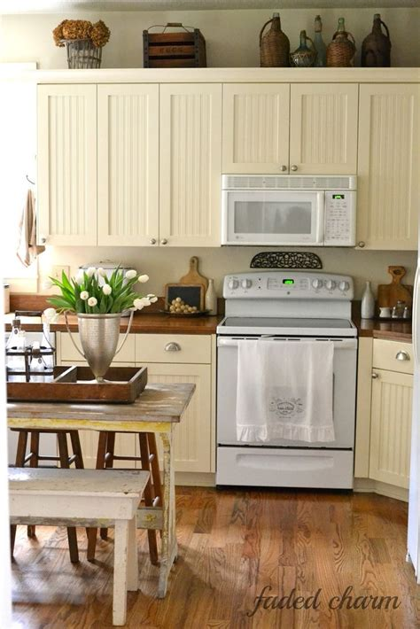 above cabinet shabby chic decor home decor pinterest faded charm cream cabinets wood counters i think white