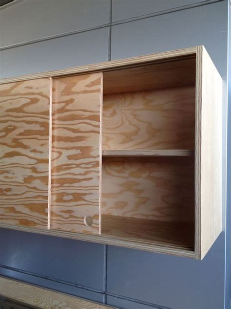 Sliding Door Shop Cabinet by Sliding Cabinet Doors And Discreet Handles Keep The