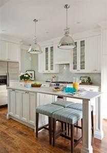 white kitchen islands with seating