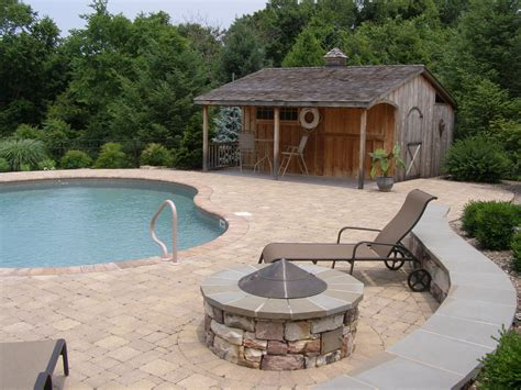 pool fire pit pool deck fire pit and wall with surrounding plantings