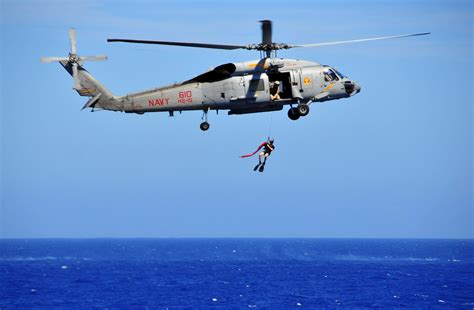 Us Navy Search File Us Navy 100216 N 4774b 760 A Search And Rescue Swimmer Is Lowered From An Sh 60f