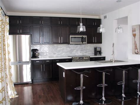 white kitchen cabinets with dark countertops kitchen with dark cabinets and white quartz counters