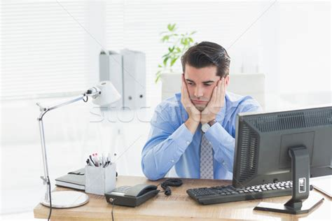 Sad Desk L by Sad Businessman Sitting At His Desk Stock Photo