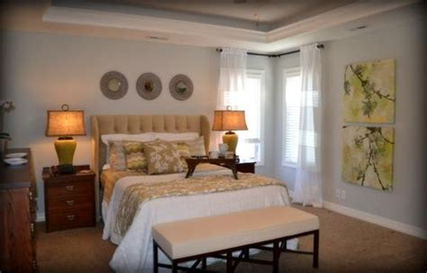 Gray and yellow master suite with upholstered wingback headboard interior design omaha fluff