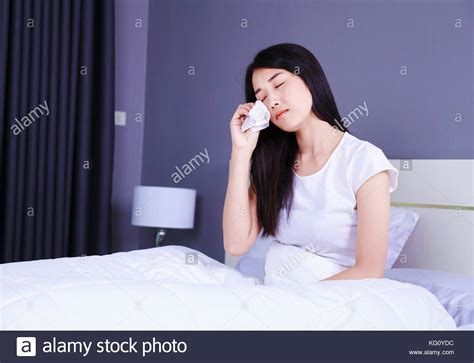 crying at home on the bedroom floor woman crying bed alone stock photos woman crying bed