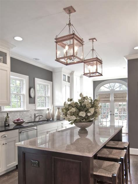 white kitchen cabinets with grey walls kitchen chandeliers pendants and under cabinet lighting