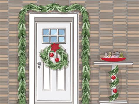 hang christmas garland  front door