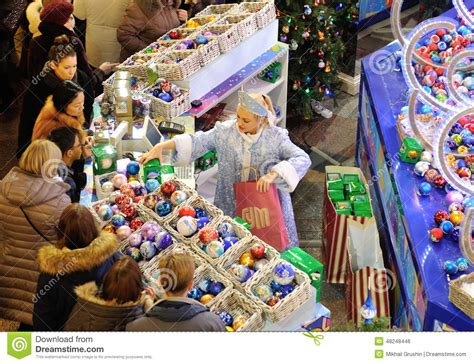 people buying christmas decorations editorial photo
