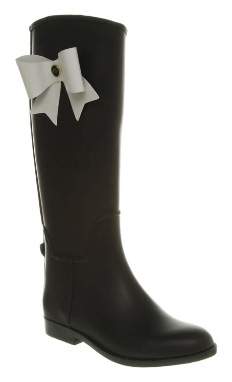 bow boots ted baker mardea bow welly boot black rubber in black lyst