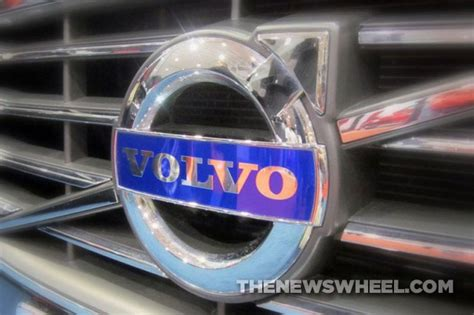 badge    volvo logo  male gender symbol  news wheel