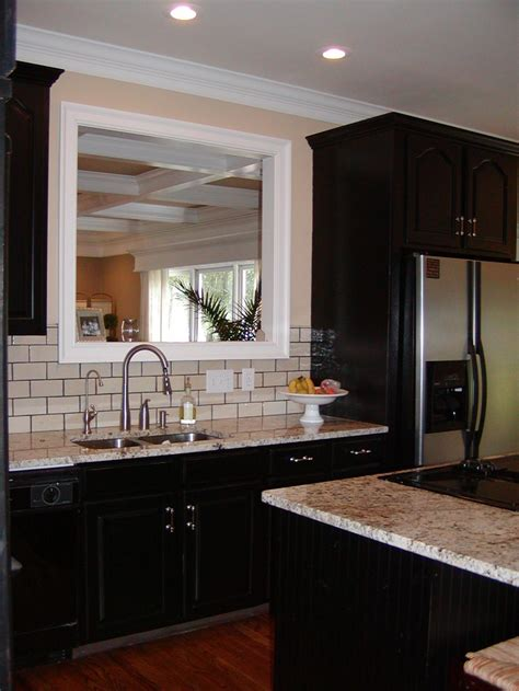 white tile backsplash dark cabinets very close to what we are doing espresso cabinets light