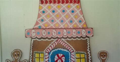 gingerbread house cut out of plywood and painted