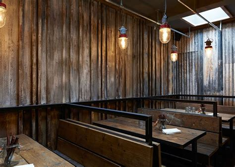 Corrugated Iron Interior Walls by Restaurant Resembling A Ramshackle Farm Building By