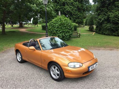 mazda mx    door convertible gold  poole