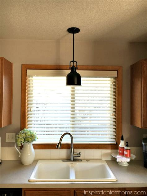 pendant light over kitchen sink updating the kitchen with new lighting inspiration for moms