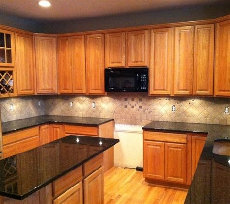 backsplash ideas for cabinets and light countertops light colored oak cabinets with granite countertop