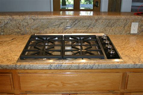 Wolf Cooktop Downdraft the wolf cooktop and thermador hurricane downdraft in place