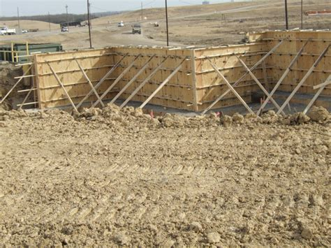 pin poured concrete retaining wall construction image