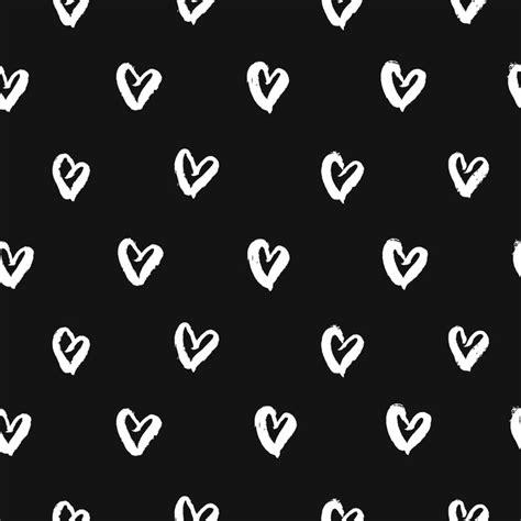 seamless pattern  hand drawn white hearts cute black