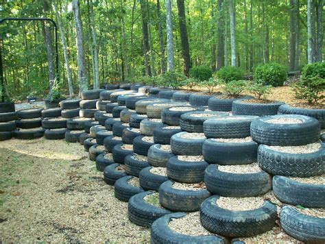 i did this retaining wall made from used tires