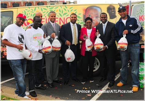 center his wife marjorie left and atlanta mayor kasim reed happy thanksgiving