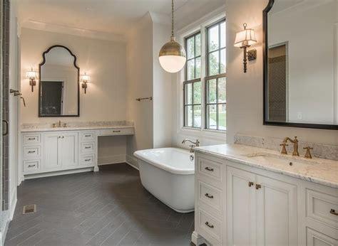 bathroom white cabinets dark floor white and gold bathroom with gray herringbone floor tiles