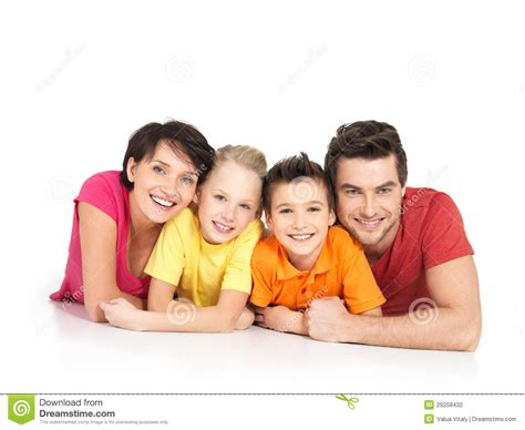 images of family happy family with two children lying on white floor stock