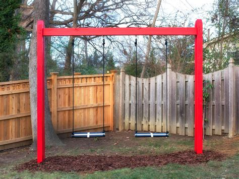 red swing set how to build a wooden kids swing set hgtv