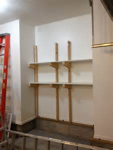 Kitchen Remodel Tool maximizing small garage spaces using diy wood custom wall