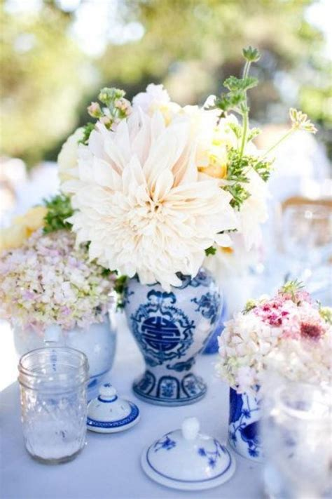 centerpieces of blue and white vases and teapots