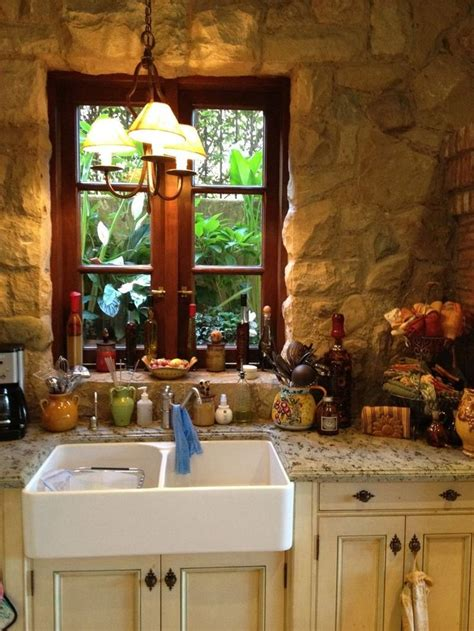 stone accent wall kitchen farmhouse with kitchen sink in the stone wall wood window and farmhouse sink with