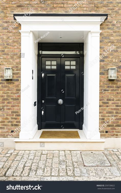 front house windows top notch front house windows black front door house glass windows stock photo door