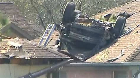 full house up on the roof car ends up in texas roof after crash bbc news