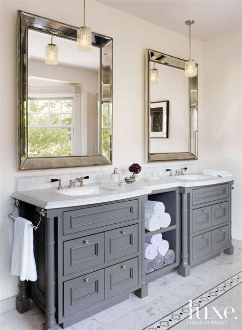 bathroom vanity and mirror ideas in the master bathroom rosenfeld hung a pair of