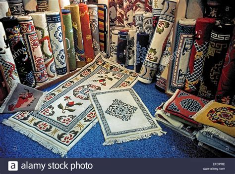 rug shops a wide selection of colorful handwoven tibetan carpets are for sale stock photo royalty free