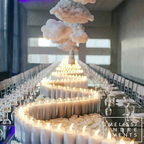 swirling candles   white wedding tablescape