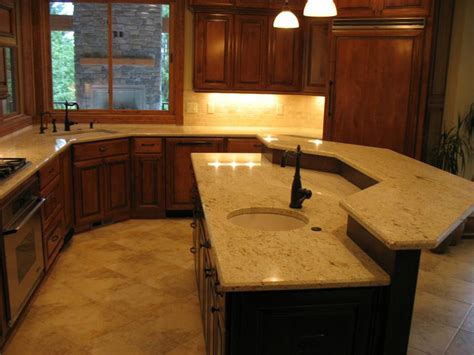 granite with cherry cabinets in kitchens colonial cream granite kitchen with cherry cabinets