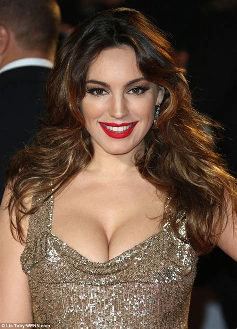 Kelly Brook dresses down before transforming into golden  for Skyfall premiere   Daily Mail