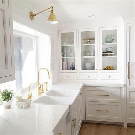 white and gold kitchen features white cabinets adorned 17 best ideas about white quartz on white kitchen decor kitchen countertop decor