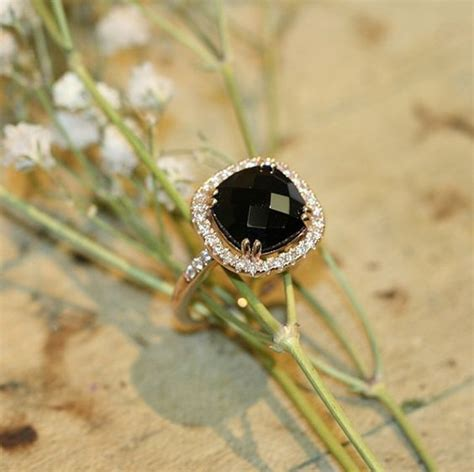 black onyx halo engagement ring in 14k