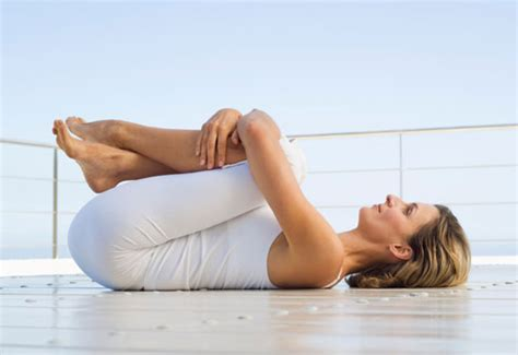 legs ache at night in bed how to stretch your lower back popsugar fitness