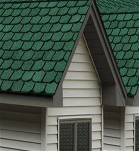 green roof paint combo sorta of mimics the color of a cedar siding or log home but painted