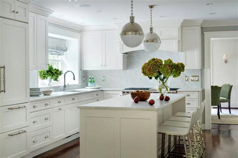 white l shaped kitchen with island white kitchen with polished nickel hicks pendants transitional kitchen